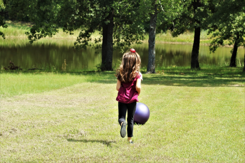 Little-girl-playing-with-ball