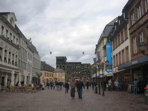Trier pedestrian zone with Roman Black Gate or Porta Nigra at the end