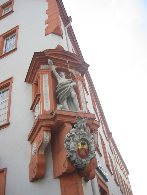 Trier, saint on a house, now a busy streetcorner over a store
