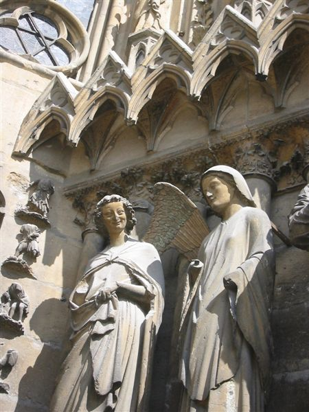 Laughing angel at Rheims Cathedral door.