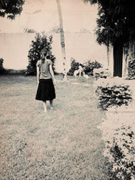 Girl_walking_on_lawn_by_penny_lane_